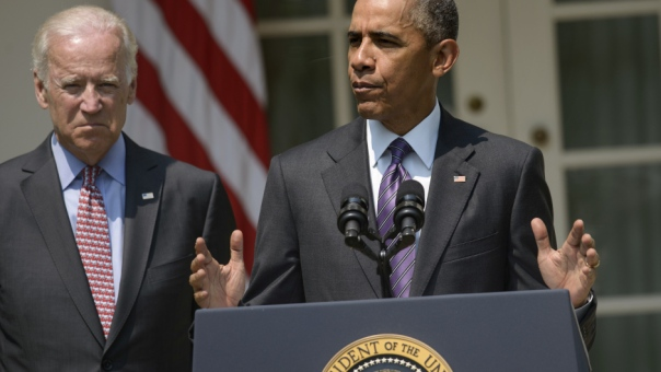 US President Barack Obama(R) speaks along side Vice President Joe Biden in the Rose Garden of the White House on July 1, 2015 in Washington, DC. Obama announced plans to reopen the US Embassy in Havana in an effort to reestablish diplomatic ties with Cold War enemy Cuba. AFP PHOTO/BRENDAN SMIALOWSKI        (Photo credit should read BRENDAN SMIALOWSKI/AFP/Getty Images)
