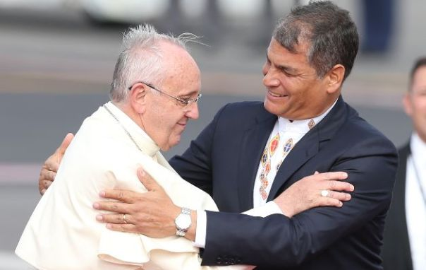 Pope Francis embraces Ecuador's President Rafale Correa upon his arrival to the Mariscal Sucre International airport in Quito, Ecuador, Sunday, July 5, 2015. History's first Latin American pope returns to Spanish-speaking South America for the first time on Sunday to visit Ecuador, Bolivia and Paraguay. (AP Photo/Fernando Llano)